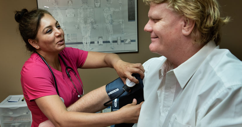a patient is having his blood pressure checked as part of the Low Testosterone program as the medical clinic