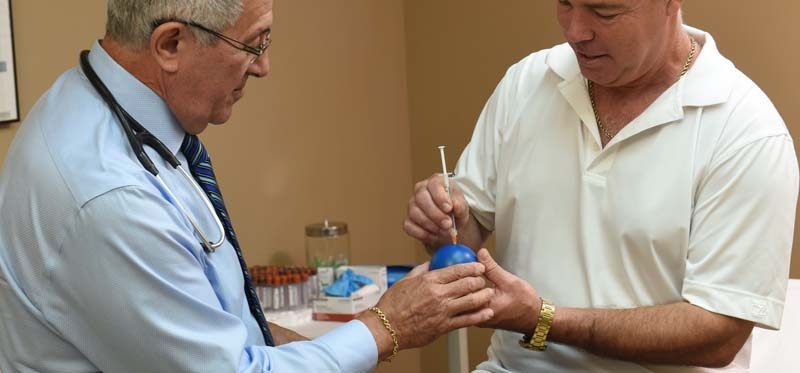 Dr. Berman shows the patient how to inject testosterone