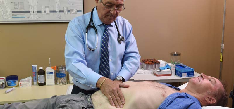 Dr. Berman examines a patent during a testosterone replacement therapy consult in Fellsmere, FL