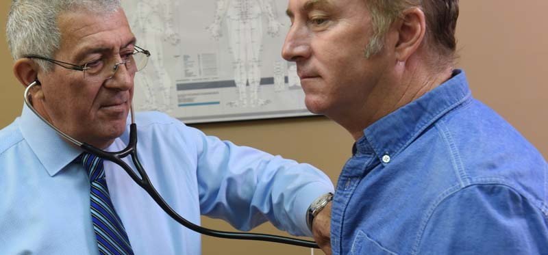 Dr. Berman examines a patient during a hormone therapy and treatment appointment in Moore Haven, FL