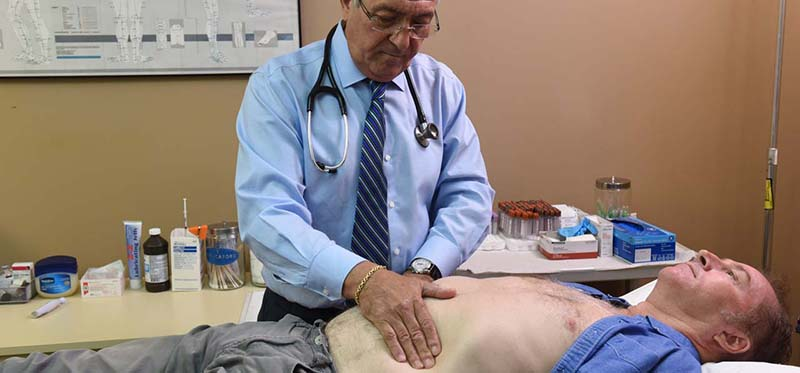 Dr. Berman icing a patient an exam at the low t center in palm beach gardens fl